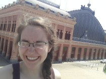 Outside the Madrid Atocha train station after several failed attempts at keeping my eyes open in the bright sun.