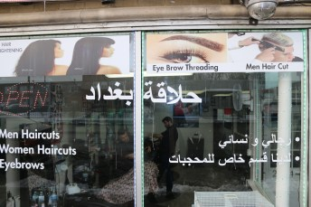 Not all of the businesses on Devon are Indian. The employees at this Iraqi barber shop primarily speak Arabic, a language spoken by less than one percent of Rogers Park residents.