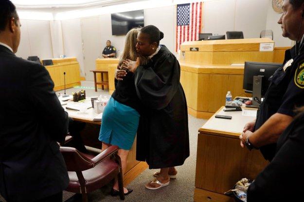 judge hugs Guyger.jpg