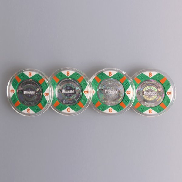 Four pieces of the limited edition Series C Green Poker chip style 25K bits Physical Bitcoin.