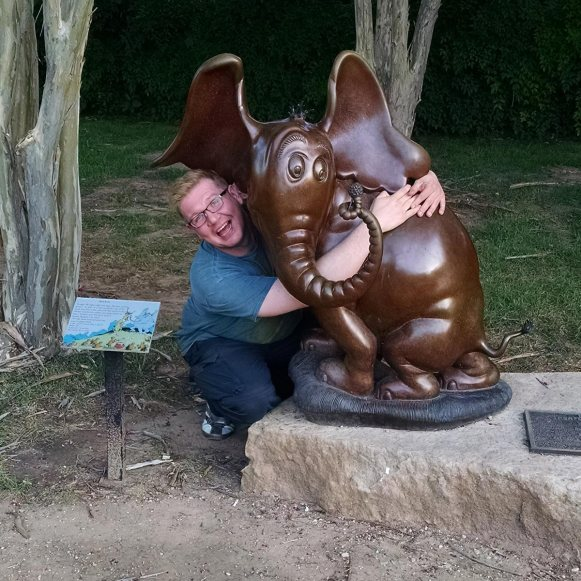 Nick hugging Horton Hears a Who sculpture in Abilene, Texas during Roguetrip to Route 66