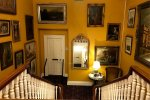 The portrait gallery in the stairwell of Ballyseede Castle gave decorating inspiration for Roguetrippers.