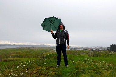Nick at a viking settlement in Norway in the rain.