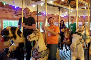 Roguetrippers riding the vintage Carrousel at the Allan Herschell Co Museum