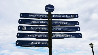 Signs pointing to Halifax waterfront attractions