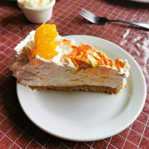 Roguetrippers enjoy creamsicle Pie when they travelled to Cheticamp
