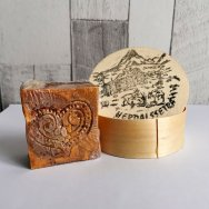 Norwegian Brown Cheese is packaged up in tight seal and decorative box as travel souvenirs for tourists.