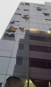 Glass Office Building With Broken Panels