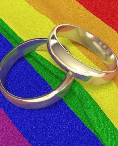 Wedding rings on rainbow coloured cloth