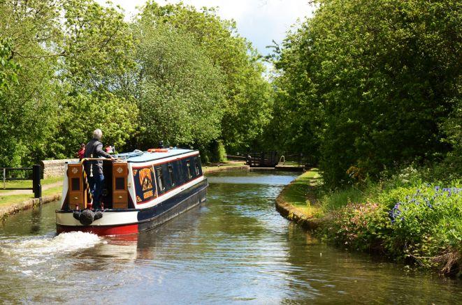 Narrowboat Content approaching Boundary Lock
