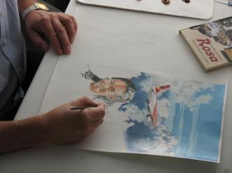 Adri Burghout aan het werk met de omslag van 'Maria, dochter uit Colombia'.