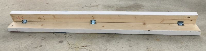 two 2x4s held together by 90 degree brackets