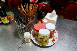 Chopsticks-and-sauces-on-a-table