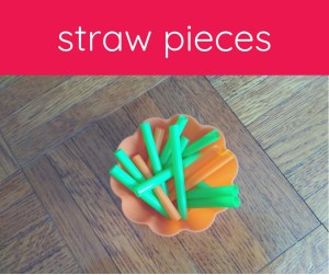 green and orange straw pieces in an orange bowl