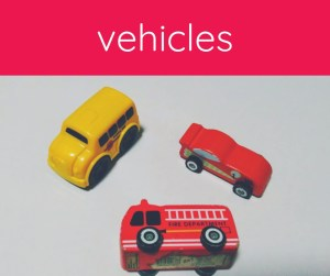 three toys: school bus, fire truck, race car