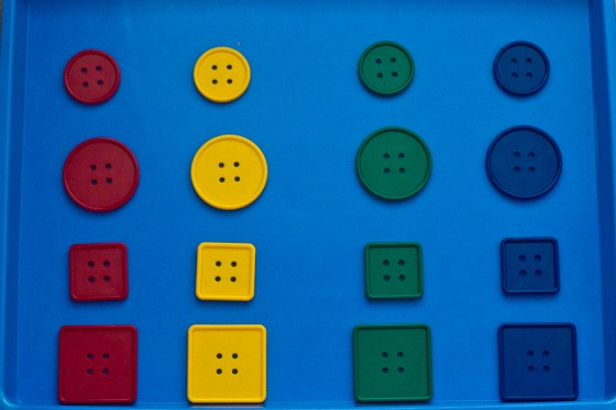 Lacing buttons also make a great activity to talk about same and different! | child development, learning through play, preschool math, toddler math, educational toys, preschool toys