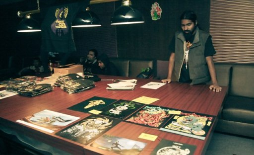 Bevar Sea guitarist and designer Rahul Chacko at his merch table. Photo: Uday Shanker