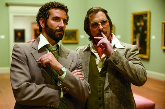 Bradley Cooper and Christian Bale discuss a con in David O. Russell's 'American Hustle'. Photo: Francois Duhamel/Columbia Pictures