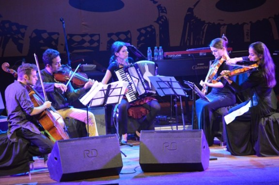 The talented string quartet performs at the tribute concert Photo Credit: