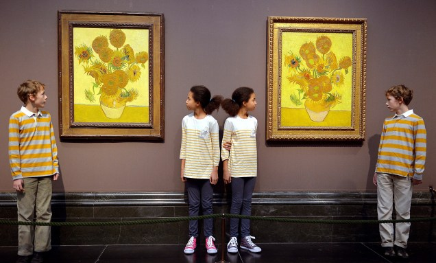 Photo taken from FInancial Times, January 2014 of the two Sunflower paintings brought together at The National Gallery.