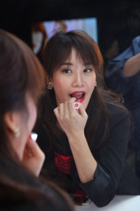 Guests testing Revlon Ultra HD™ Lipstick in HD Gladiolus