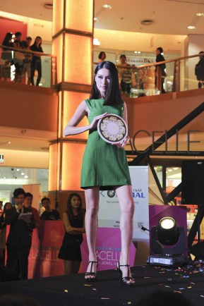 Amber Chia (model) wearing Bausch and Lomb Lacelle Jewel Peridot Green