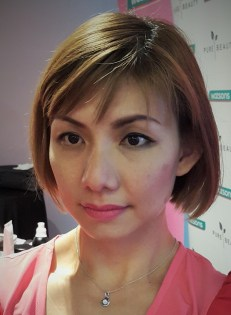 Elana with half make up on