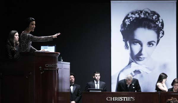 A Christie's auctioneer conducts an auction of Elizabeth Taylor's jewelry, clothing, art and memorabilia in New York