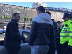 """(Video) Doru Oprea: """"Doi romani si-au lăsat mașina stricata pe trotuar in fata unei stații de metrou din Anglia. Politia a venit si le-a detonat-o cu ajutorul unui robot. Privirea uimita a celor doi romani reveniți la mașina face toți banii"""" 61"""