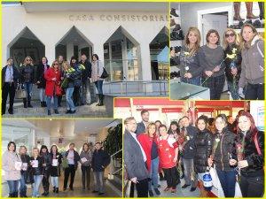 Echipa PNL Arganda del Rey oferind flori femeilor care lucrează în Arganda del Rey