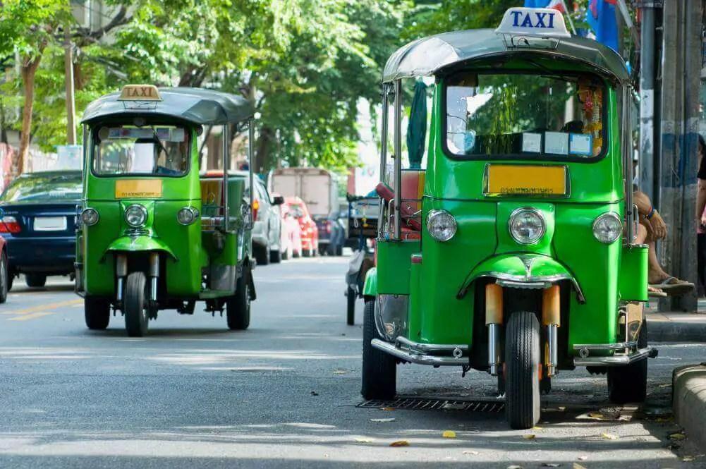 Tuk tuk taxis on the street in Bangkok, Thailand