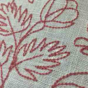 Heat away stabilizer left behind on fabric.