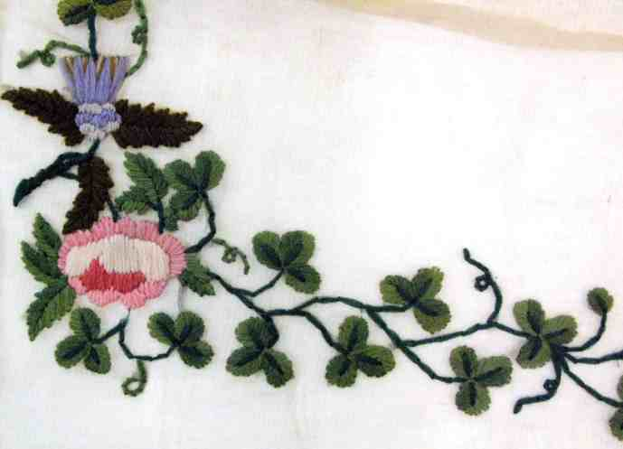Embroidery Inspiration | Shamrocks and Clovers. Apron embroidered with shamrocks, roses, and thistles.