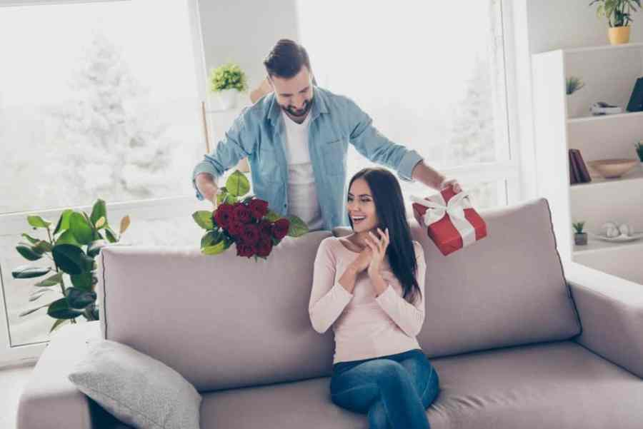 Man Giving Gifts To His Wife