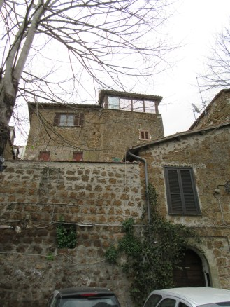Looking up at a medieval tower in Sutri