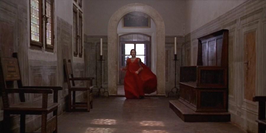 Juliet running down corridor