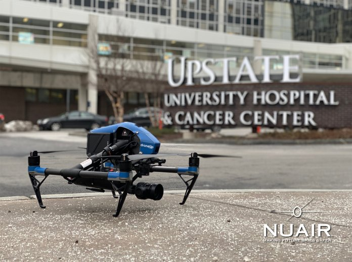 MISSION ACCOMPLISHED — An unmanned aerial system (drone) rests on the sidewalk after a successful test mission to see how the systems can aid in the ongoing fight against COVID-19. The drone performed a series of challenges in Syracuse, demonstrating ways that drones can be used to safely and quickly assist hospitals and other health care professionals.