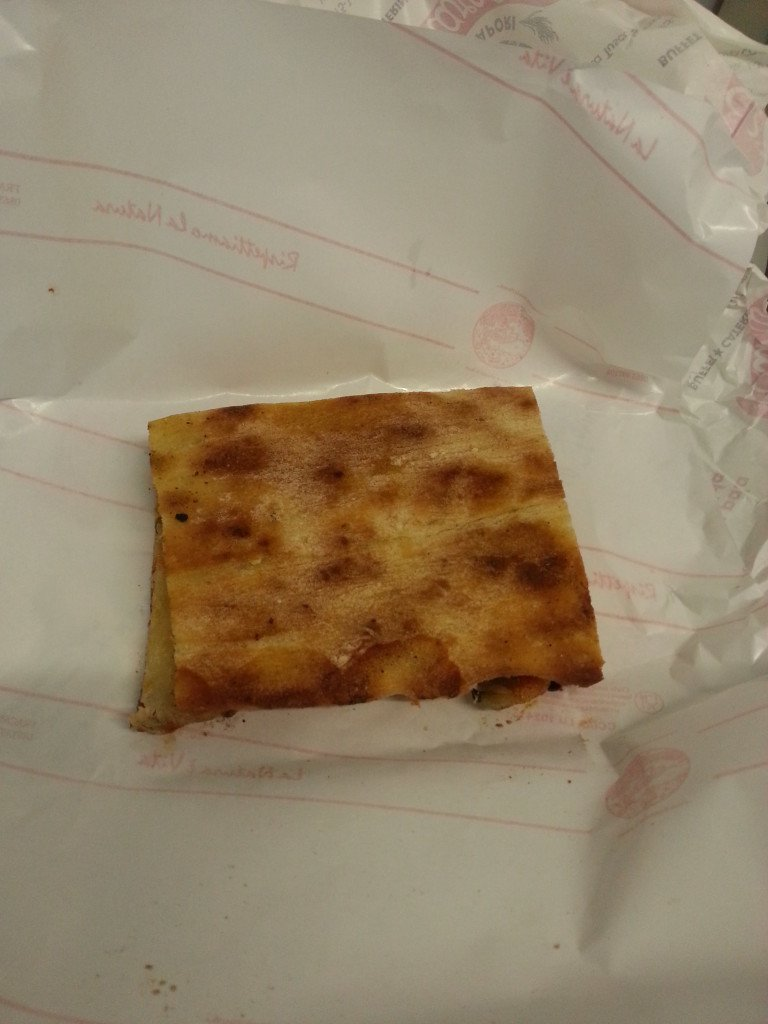 A folded pizza slice in Rome