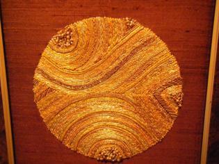 Gold work piece by Joyce