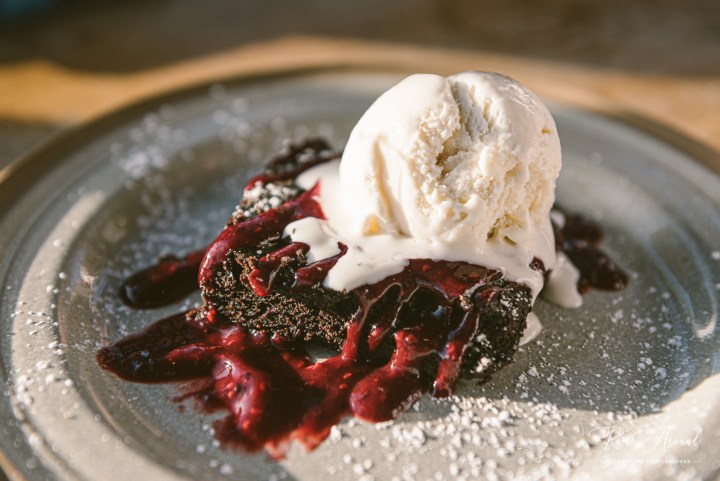 Vegan brownie, cider berry coulis and vanilla ice cream