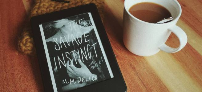 Marjorie DeLuca The Savage Instinct cover on ebook with coffee