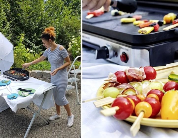 Sommerliche Grillspieße und Frau am Elektrogrill