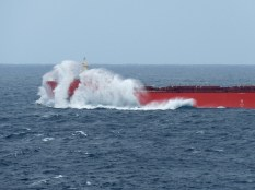 A passing tanker in rough sea
