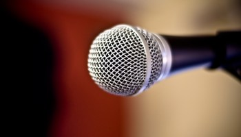 Close up of metal microphone against defocused background
