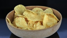 Kettle type potato chips in a wooden bowl
