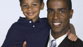 Father holding son (3-5), portrait