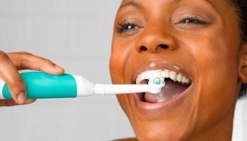 Black woman white teeth