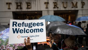 Protestors Rally Against Immigration Ban On Wall Street