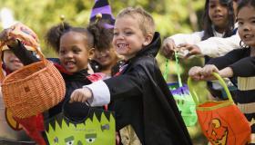 Multi-ethnic children dressed in Halloween costumes