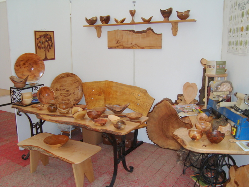 Examples of Roni Roberts wood turning displayed in a craft fair